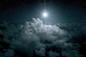 Fototapeta The star shines over the manger of christmas of Jesus Christ. obraz