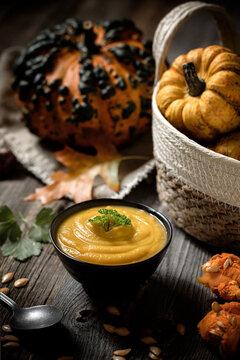 delicious autumn pumpkin soup and pumpkins