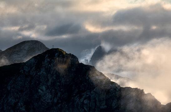 beautiful sunlight around clouded mountain top