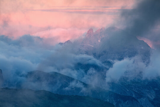 dramatic foggy purple sunrise in Alps