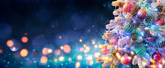 Obraz Christmas Tree With Ornaments In Blue Night - Balls On Fir Branches With Defocused Lights In Abstract Background - fototapety do salonu