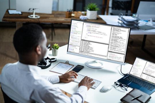 African American Web Coder At Computer. Software Programmer