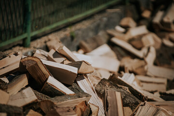 Closeup shot of piled firewood prepared for winter