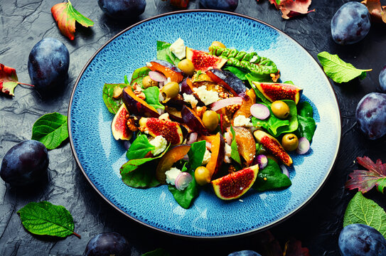 Autumn salad with fruit and green