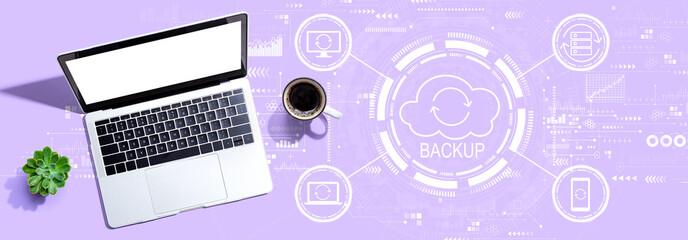 Fototapeta Backup concept with a laptop computer on a desk obraz