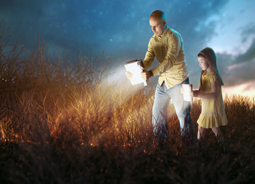 Father and Daugther with glowing Bibles