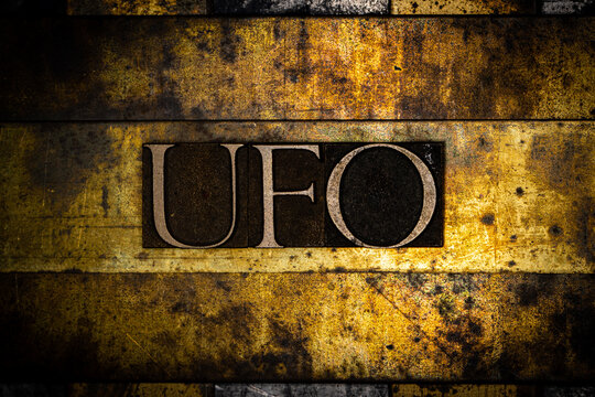 UFO text on textured grunge copper and vintage gold background