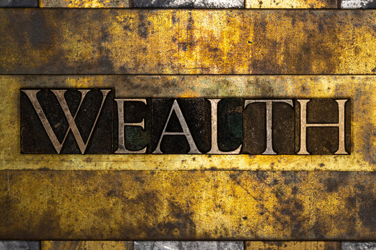 Wealth text on textured grunge copper and vintage gold background