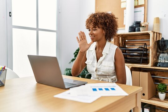 Young african american woman having video call using deaf language at office