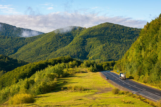 country road in early morning. beautiful mountain scenery in autumn