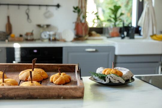 desk with pumpkin cookies at kitchen