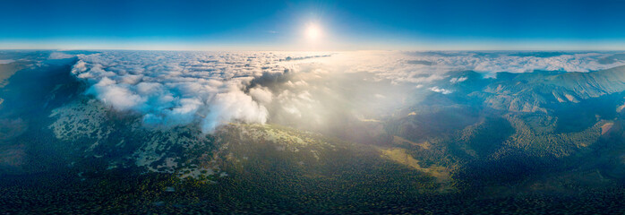 Fototapeta Flight over the misty mountain Syvulya obraz