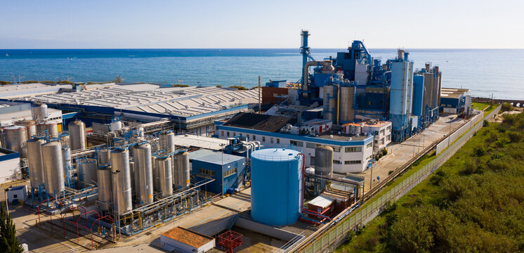 Aerial view of industrial facilities of Mataro factory producing detergent and air fresheners, Costa del Maresme, Spain..