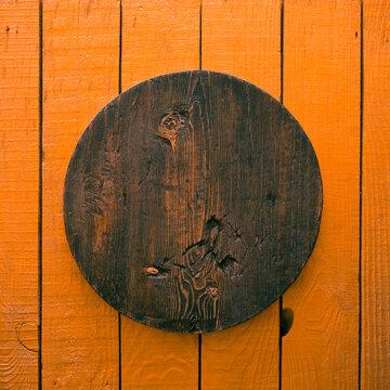 wooden plate, orange background