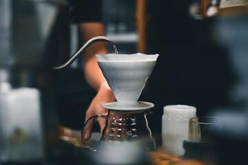 Obraz Drip coffee on a table in a coffee shop - fototapety do salonu
