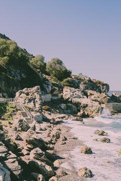 Islands Ocean Tropical Beach Landscape. View on cliffs and rocks.