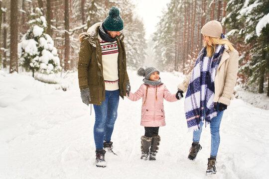 Family walking during the winter season