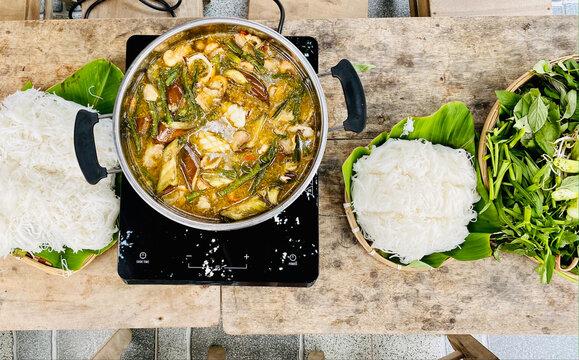 Vietnamese hot pot with fish sauce, rice noodle