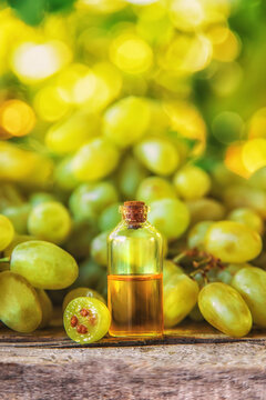 Grape seed oil in a bottle. Selective focus.