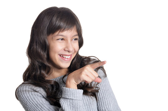 Portrait of cute girl pointing and posing isolated
