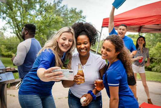 Friends taking a selfie at a tailgate party