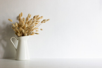 Obraz Organic brown flowers in a vase with nature light.  - fototapety do salonu
