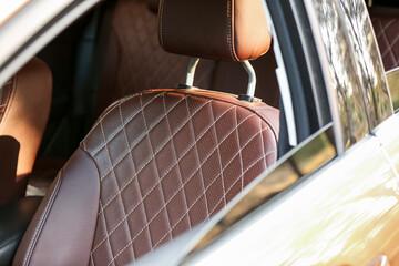 Fototapeta Brown leather seat in modern car obraz