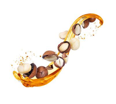 Splash of oily liquid with crushed macadamia nuts