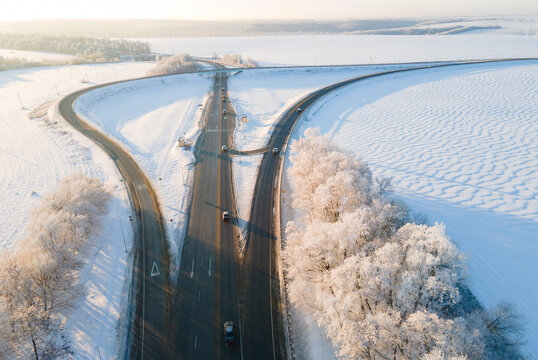 Highway intersection junction winter morning with car. Drone Aerial Top View