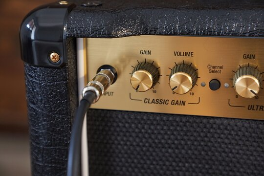 Guitar amplifier closeup, cable connected