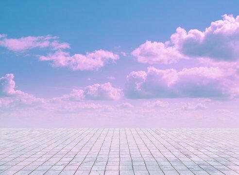 pink clouds, blue sky, gray floor.