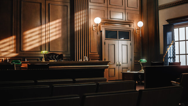 Empty American Style Courtroom. Supreme Court of Law and Justice Trial Stand. Courthouse Before Civil Case Hearing Starts. Grand Wooden Interior with Judge's Bench, Defendant's and Plaintiff's Tables.