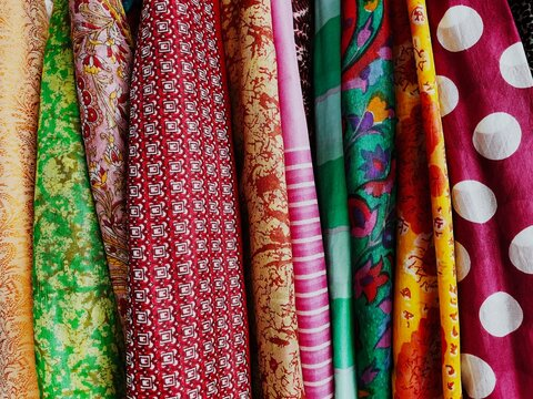 Texture And Detail Of Colorful Clothes. Fabric Hanging.