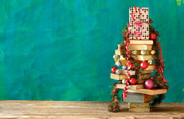 Obraz Giving books for christmas with christmas tree and decoration.Reading,literature,education,gift,present,christian holiday concept, copy space - fototapety do salonu