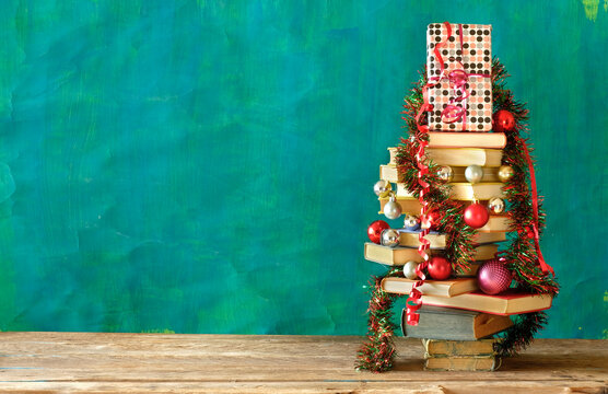 Giving books for christmas with christmas tree and decoration.Reading,literature,education,gift,present,christian holiday concept, copy space
