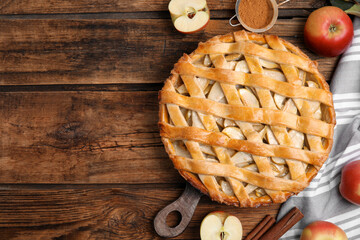 Obraz Delicious traditional apple pie on wooden table, flat lay. Space for text - fototapety do salonu