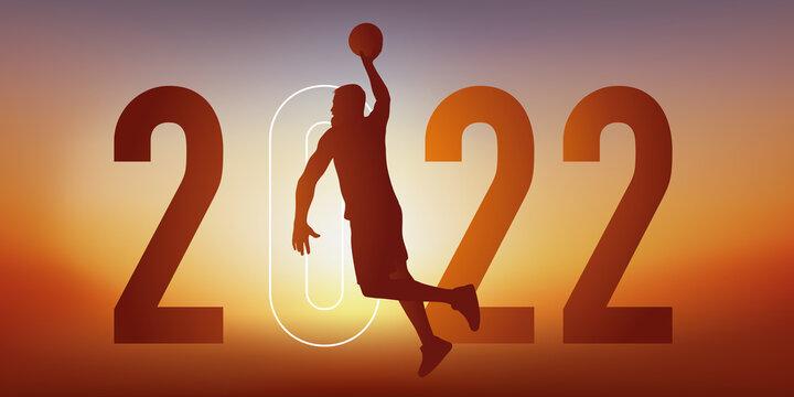 Concept du sport sur le thème du basket pour une carte de vœux 2022, montrant un basketteur sautant le bras tendu pour marquer un panier.