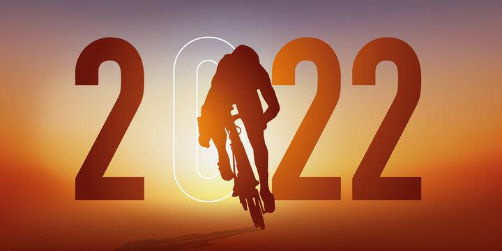 Concept du sport sur le thème du cyclisme pour une carte de vœux 2022, montrant un cycliste qui sprint pour passer la ligne d'arrivée.
