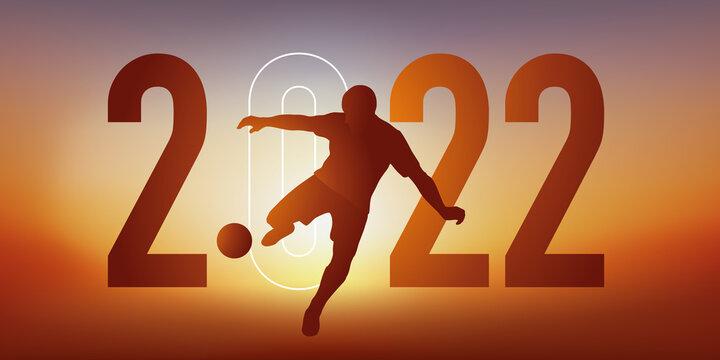 Concept du sport sur le thème du football pour une carte de vœux 2022, montrant un footballeur qui frappe le ballon du pied pour marquer un but.