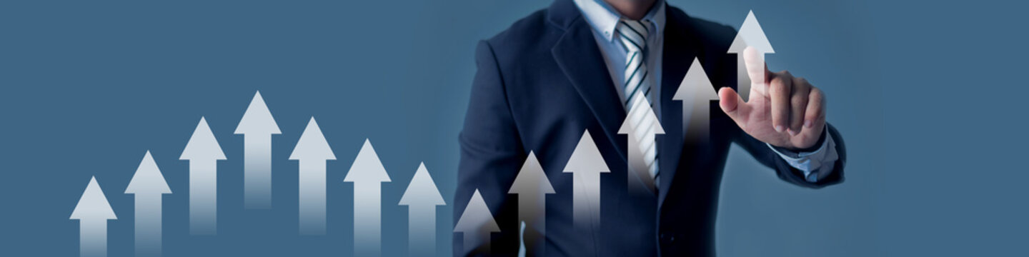Business man pointing on arrow up of graph