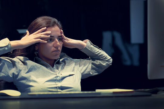 Upset office worker manager woman sitting in front of the monitor of computer. Expression emotion feelings problems, stress