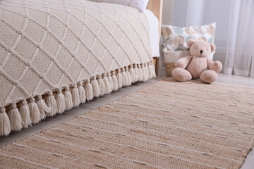Obraz Stylish children's room interior with beige rug and bed - fototapety do salonu