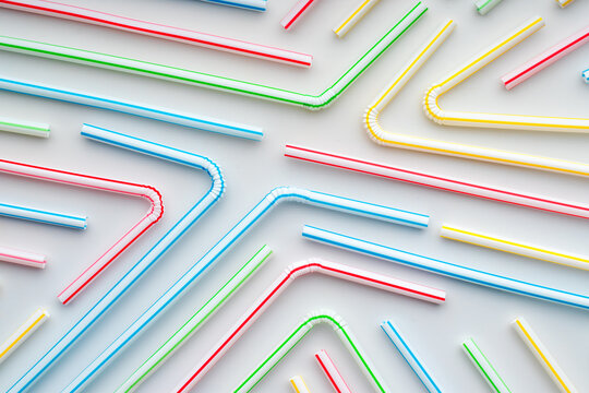 Plastic straws with colorful stripes