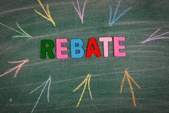Rebate, business concept. Word and colored arrows on the green board