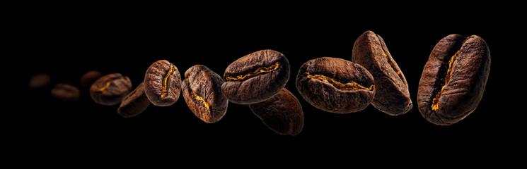 Fototapeta Coffee beans levitate on a black background obraz