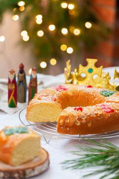 Traditional Spanish Epiphany cake, Roscon de Reyes with festive decorations
