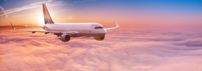 Obraz Commercial airplane flying above dramatic clouds. - fototapety do salonu
