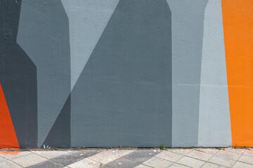 Modern urban scene with empty street and colorful geometrical wall. Creative modern urban city...