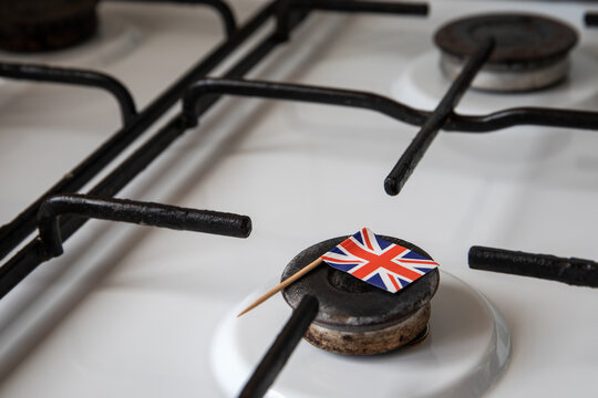 Natural gas exports and imports. High price. British flag on gas stove