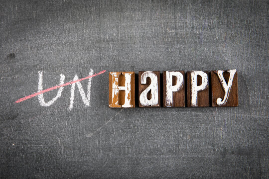 Happy and Unhappy concept. Black chalk board background